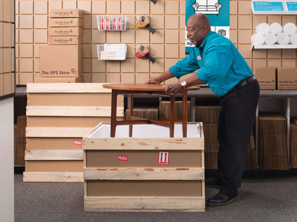 The UPS Store franchisee crating a table