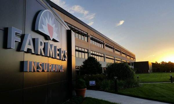 Farmers sign and agency's building during sunset