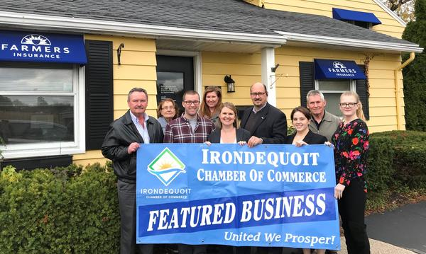 Farmers agency posing with banner that reads Irondequoit Chamber of Commerce - Featured Business of the Month