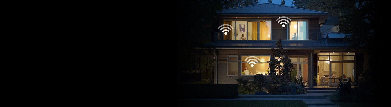 Photo of home at dusk fully connected with Optimum Whole Home Wifi service