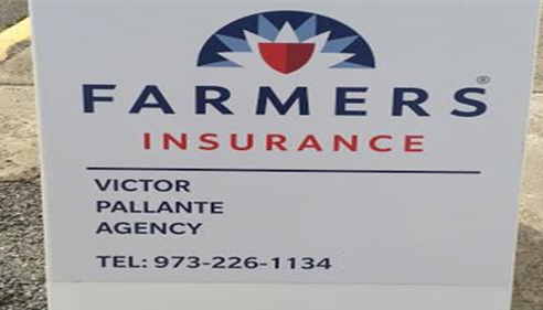 Lawn sign with the Farmers logo and the agent's name