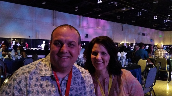 A photo of Farmers Agent Jamie Slate posing with his wife.