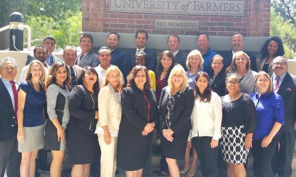 Agent Felicia Traylor and her graduating class at University of Farmers.