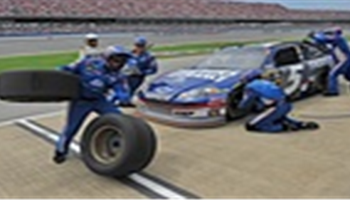 Changing the tires for the Farmers® race car at the Talladega Superspeedway.