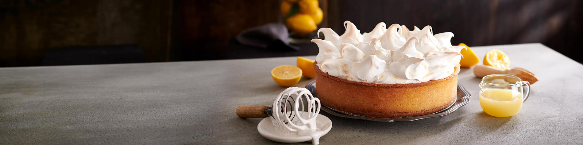Mugg & Bean's lemon cake served on a grey table.