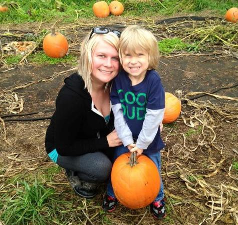 Mother and son at a pumpkin patch