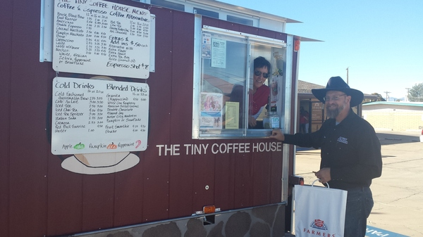 A local traveling coffee vendor giving free coffee to one of our customers!