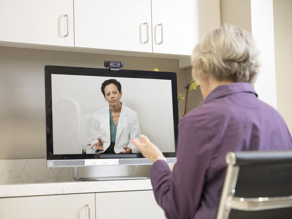 Senior woman uses computer for telehealth visit