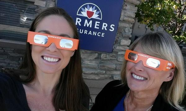 Two staff members with silly glasses on.