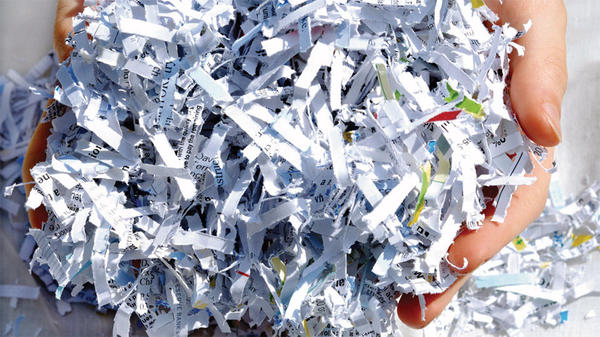 shredded paper in hands