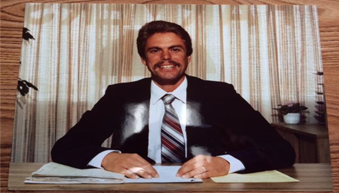 A picture of a photograph of the agent from the 70's.