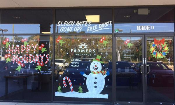 Photo of holiday decorations on a Farmers Agency window.