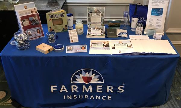 The Felder Farmers Insurance Agency promotional table.