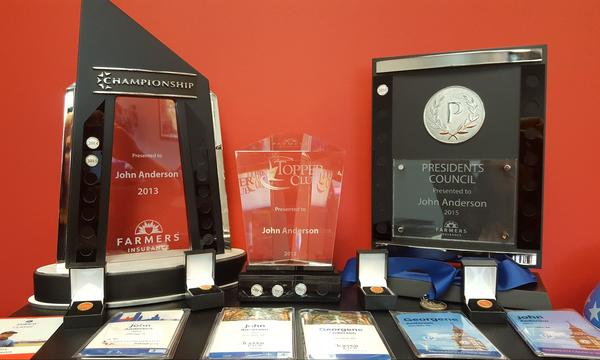 Photo of John's awards and accolades