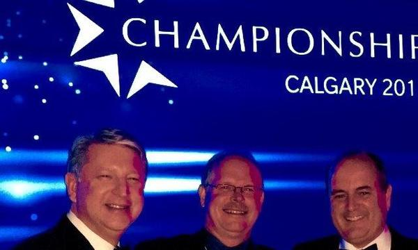 Agent standing with 3 men at the Championship gala