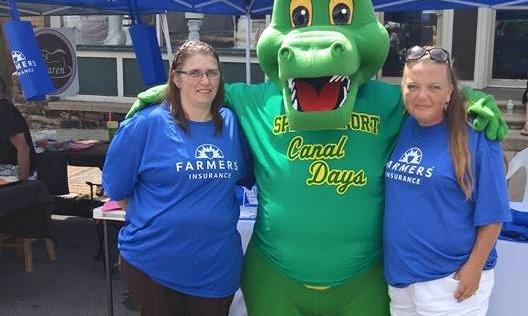 Agent Debra Jones and a female staff member standing with someone in a green monster costume that says Spencerport Canal Days