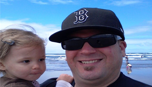Spencer with his daughter Ava at the Oregon Coast