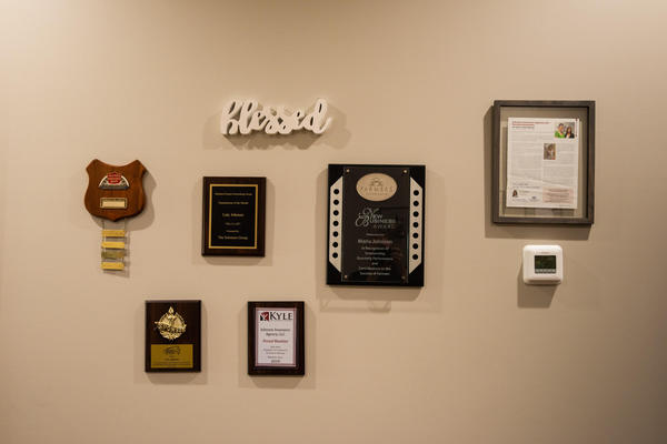 Image of several awards hanging on a wall