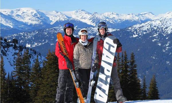 Family skiing and snowboarding