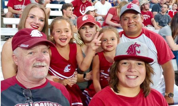 The agent with his family at a Cougars game