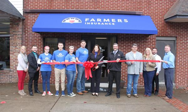 Farmers Insurance Staff cutting the red ribbon to their new office location