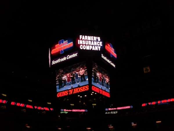 Farmers Insurance Company displaying on the Megatron at a sporting event