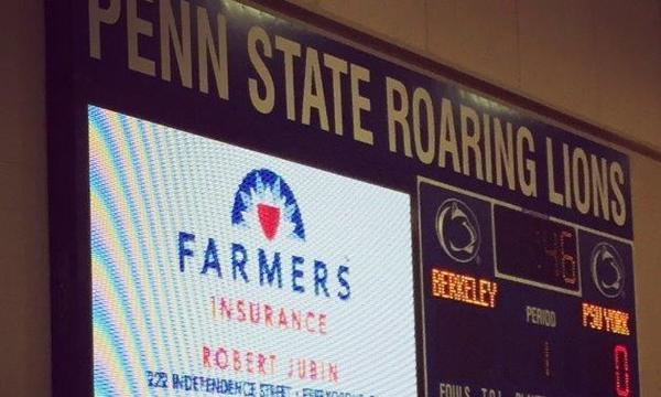 The scoreboard at a Penn State sporting event which features an ad for Farmers Insurance Robert Jubin Agency.