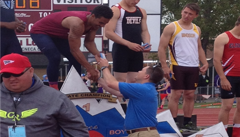 Darin handing out medals at the 2014 Colorado State Track meet