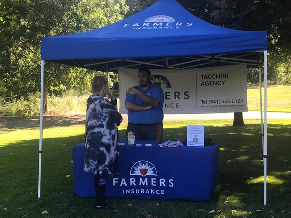 Farmers agent booth at summer concert series
