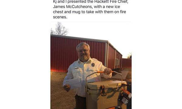 Giving ice chest to the local fire department.