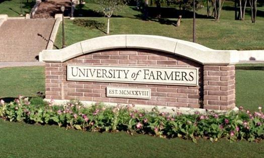 The brick University of Farmers sign