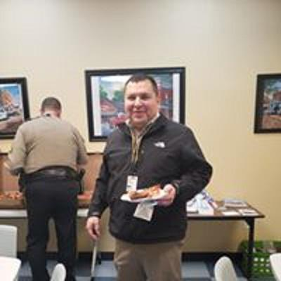 PC  Officer Valeriano enjoying pizza and gift bag.