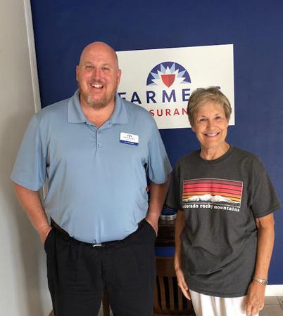 Farmers Agent Chris Pinckney with new policyholder.