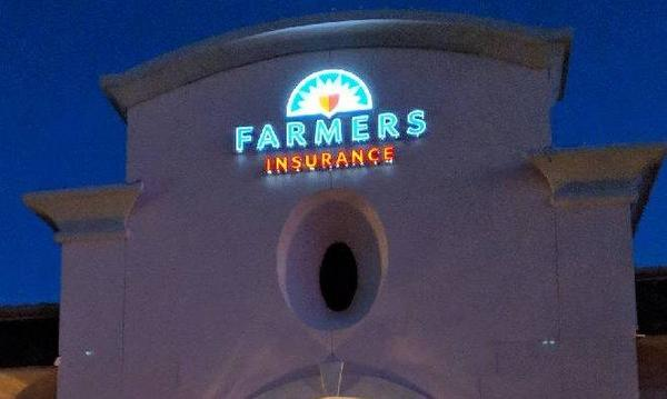 storefront view of Farmers Insurance sign above agent's office.