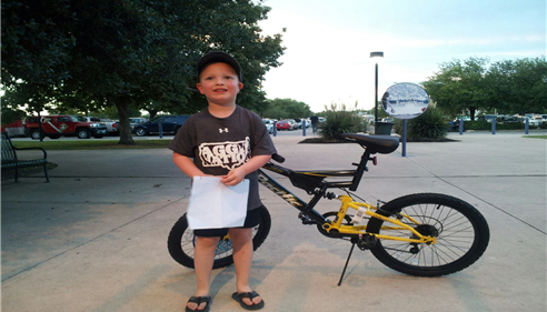 Our bike winner at the San Antonio Missions baseball game.