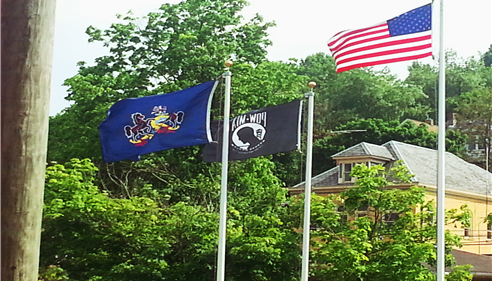 Look for the 3 flags flying proud when you visit our office!