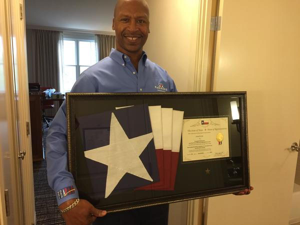 Agent holding Texas flag