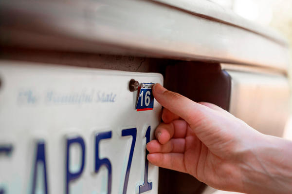 license plate with car registration stickers renewed at AAA