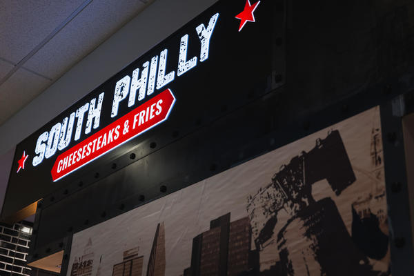 South Philly cheesesteaks & fries store front sign