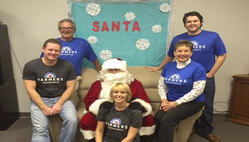 Our team with Santa at our Santa & Cookies Open House event!