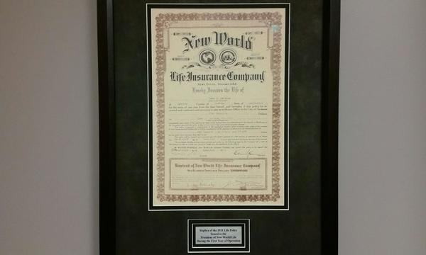 A framed old school contract from Farmers.