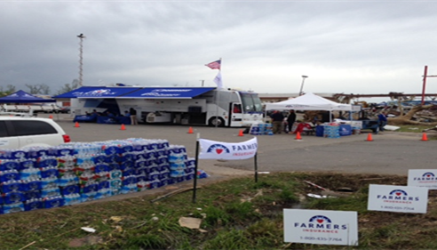 Farmers® Catastrophe bus set up assisting with Tornado recovery in Arkansas.