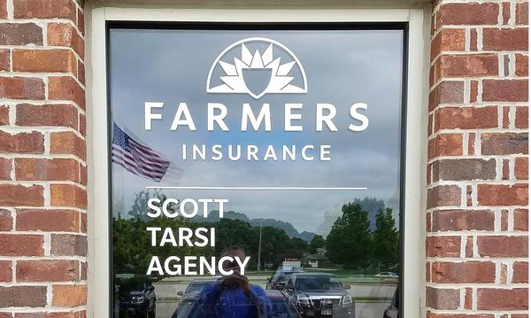 The front window of the Farmers Insurance Scott Tarsi Agency.