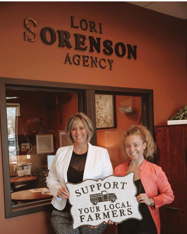 Two women standing in front of an agency