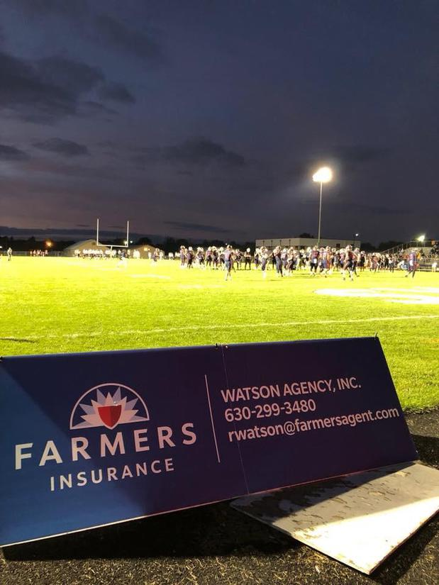 farmers insurance sign on oswego high school field