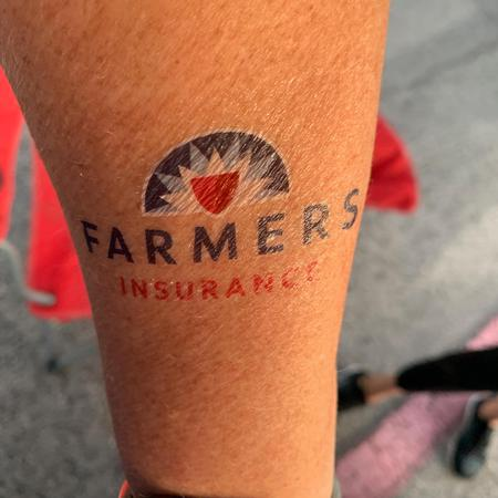 Image of a temporary tattoo of the Farmers logo