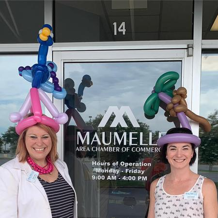 Maumelle Chamber members posing for picture with balloon hats on.