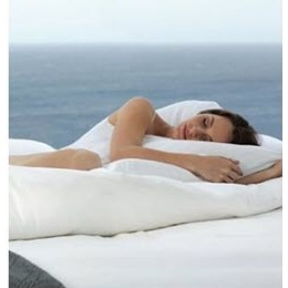 A woman sleeping on a Cariloha mattress