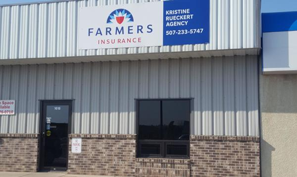 A white office building with the Farmers logo