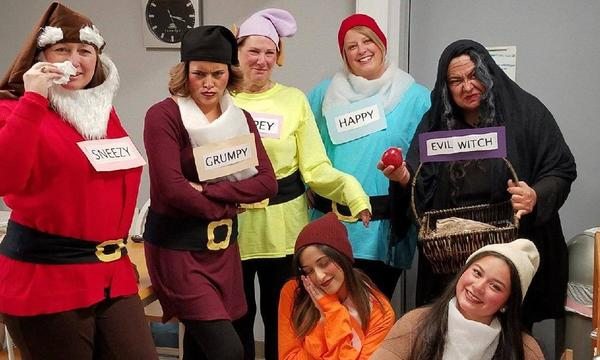 Janna and her team are all dressed up as characters from Snow White